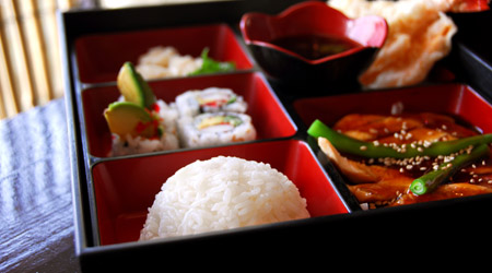 Assorted japanese food bento served a wooden box